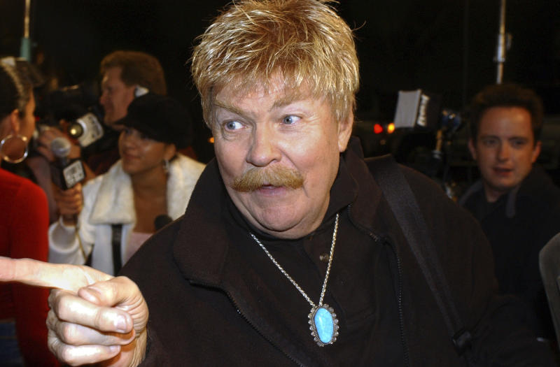 CORRECTS AGE TO 88 - FILE - In this Monday, Oct. 21, 2002, file photo, comedian Rip Taylor talks with reporters before a film premiere, in the Hollywood section of Los Angeles. Taylor, the mustached comedian with a fondness for confetti-throwing who became a television game show mainstay in the 1970s, died Sunday, Oct. 6, 2019. He was 88. (AP Photo/Rene Macura, File)
