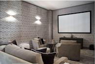 """<p>Sure, basements are dark and quiet, which makes them all the better for a home cinema! This one by designer <a href=""""http://kishaniperera.com/"""" rel=""""nofollow noopener"""" target=""""_blank"""" data-ylk=""""slk:Kishani Perera"""" class=""""link rapid-noclick-resp"""">Kishani Perera</a> eliminates the dungeon-like quality of a dark movie theater with light-colored sofas and armchairs and a patterned wall covering.</p>"""