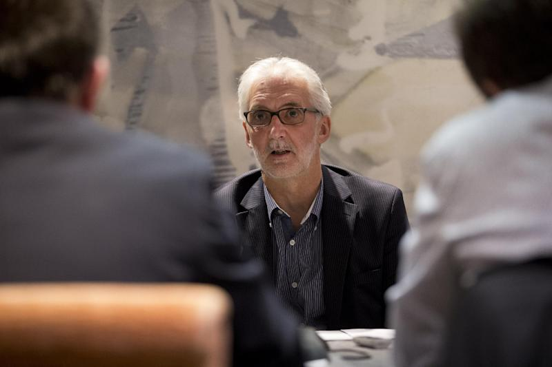 "British Cycling president Brian Cookson speaks during a round-table question and answer session with journalists in London, Tuesday, June 4, 2013. Cookson will challenge Pat McQuaid for the presidency of the International Cycling Union in a bid to restore the sport's reputation. Cookson, who had previously backed McQuaid's re-election bid, said in a statement provided by British Cycling that the ""widespread absence of confidence in the integrity of the organization"" led him to challenge the incumbent. (AP Photo/Matt Dunham)"