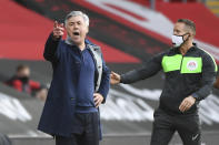 Everton's manager Carlo Ancelotti, left, shouts next to an official during an English Premier League soccer match between Southampton and Everton at the St. Mary's stadium in Southampton, England, Sunday Oct. 25, 2020. (Andy Rain/Pool via AP)