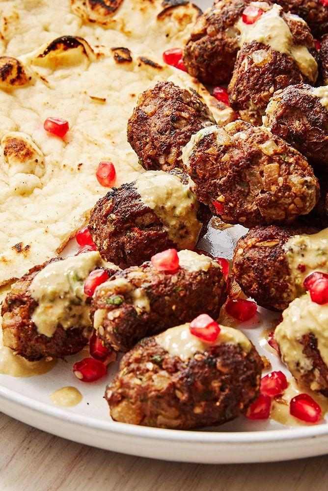 """<p>Koftas are SUCH a great dinner choice, easy to make, but look seriously fancy. We love using a mixture of minced lamb and beef and serving with a tahini dressing, flatbreads and pomegranate. </p><p>Get the <a href=""""https://www.delish.com/uk/cooking/recipes/a29725444/lamb-kofta/"""" rel=""""nofollow noopener"""" target=""""_blank"""" data-ylk=""""slk:Lamb Kofta"""" class=""""link rapid-noclick-resp"""">Lamb Kofta</a> recipe.</p>"""