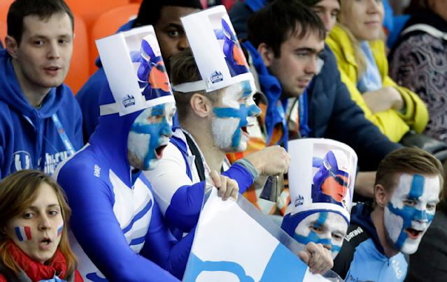 Fans of Finland's Pekka Koskela watch the first heat of the men's 500-meter speedskating race at the Adler Arena Skating Center during the 2014 Winter Olympics, Monday, Feb. 10, 2014, in Sochi, Russia. (AP Photo/David J. Phillip )