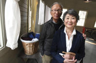 In this Friday, Oct. 1, 2021, photo principal donors, Franklin and Sandra Yee from Sacramento, Calif., attend the dedication ceremonies of the restored 1917 Chinese Laundry building at Wawona in Yosemite National Park, Calif. Officials unveiled on Friday a new sign and exhibit inside a building originally used as a laundry by Chinese workers at Yosemite's Wawona Hotel, formally recognizing Chinese Americans' contributions to the national park's history. (John Walker /The Fresno Bee via AP)