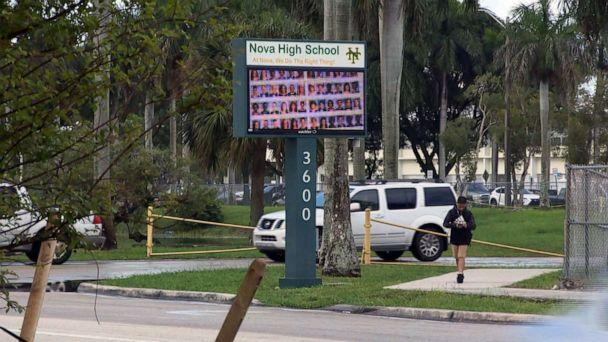 PHOTO: People pass by the entrance to Nova High School in Davie, Fla., Aug. 22, 2019. (WPLG)