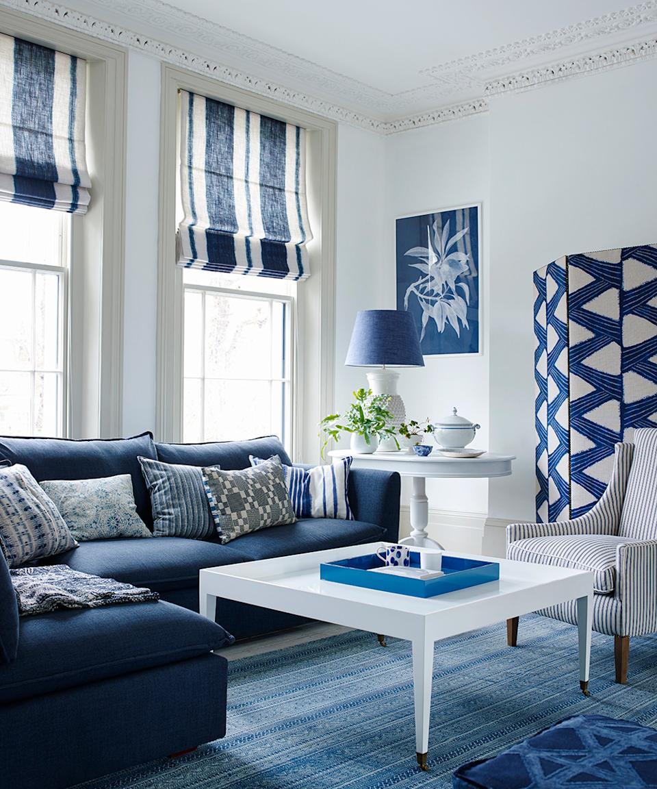 Best ways to add value with home improvements, such as a freshly decorating living room in blue and white