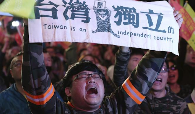 A supporter of President Tsai Ing-wen cheers for her victory in Taipei on Saturday. Photo: AP