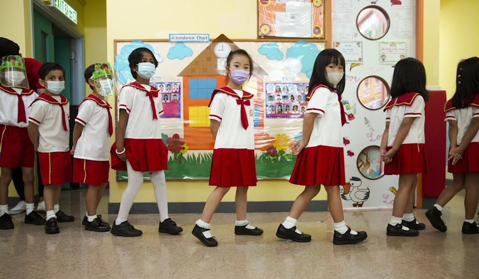 Kindergarten students at Sun Island English Kindergarten, Belcher Branch. The first free flu shots would be given to children at 450 primary schools and 760 kindergartens, as well as childcare centres that have signed up. Photo: Winson Wong