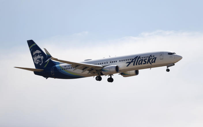 An Alaska Airlines jetliner lands in the main terminal of Denver International Airport late Monday, June 22, 2020, in Denver. (AP Photo/David Zalubowski)
