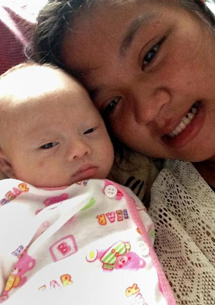 Undated photo shows Thai surrogate mother Pattaramon Chanbua posing for a photo with her baby Gammy, born with Down Syndrome, at the Sriracha district in Chonburi province (AFP Photo/Pattaramon Chanbua)