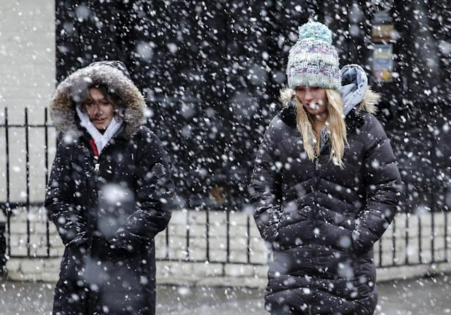 <p>Women walk on a street as snow falls during winter storm Quinn on March 7, 2018 in Hoboken, N.J. This is the second nor'easter to hit the area in a week, and is expected to bring heavy snowfall and winds, raising fears of another round of electrical outages. (Photo: Kena Betancur/Getty Images) </p>