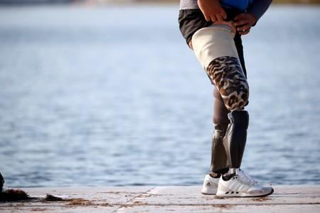 Former South Korean Army sergeant Ha Jae-hun, who lost both his legs in 2015 when he stepped on a North Korean landmine while on a patrol in the DMZ, puts on his artificial legs after a practice session at Misari Rowing Stadium in Hanam, South Korea