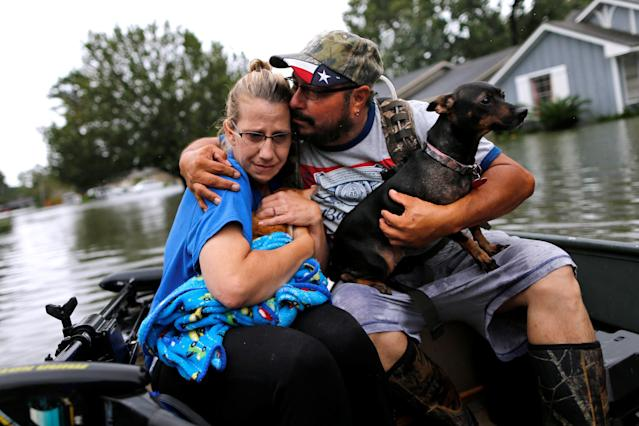 <p>David Gonzalez comforts his wife Kathy after being rescued from their home flooded by Tropical Storm Harvey in Orange, Texas, Aug. 30, 2017. (Photo: Jonathan Bachman/Reuters) </p>