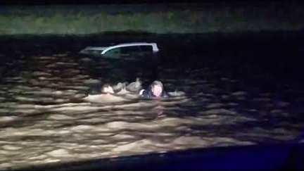 "<p>Two brothers came to the aid of a woman who was trapped on top of her car as it was sinking in frigid floodwaters in <a href=""https://roadsidethoughts.com/mt/dunkirk-xx-toole-census.htm"" target=""_blank"">Dunkirk, Montana,</a> on Tuesday night, April 17.</p><p>Matt and Seth McCollam were driving back through Dunkirk from a job in North Dakota when they came to an intersection on <a href=""http://www.dangerousroads.org/north-america/usa/4950-montana-state-highway-2.html"" target=""_blank"">Highway 2</a> that was completely flooded.</p><p>They saw a car sinking into the floodwater and could see that there was a person yelling for help on top of it.</p><p>Seth McCollam swam out to the woman and helped her back to safety. His brother Matt recorded the dramatic scene on his phone.</p><p>According to a local <a href=""https://www.usnews.com/news/best-states/montana/articles/2018-04-19/passing-motorist-rescues-woman-trapped-by-montana-flooding"" target=""_blank"">report</a> the brothers gave the woman a blanket and helped her to warm up before driving her to meet her husband. Credit: Matthew McCollam via Storyful</p>"