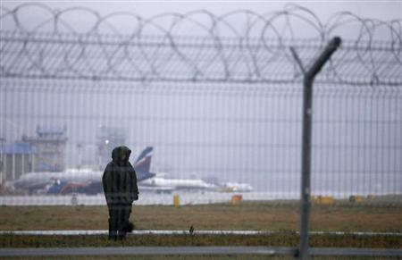 Russian police officer stands guard in front Sochi's airport in Adler