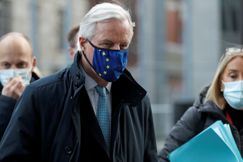 FILE PHOTO: European Union's chief Brexit negotiator Michel Barnier, wearing a face mask, leaves the Brexit trade negotiations in London