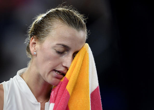 Petra Kvitova of the Czech Republic wipes sweat from her face during her women's singles final against Japan's Naomi Osaka at the Australian Open tennis championships in Melbourne, Australia, Saturday, Jan. 26, 2019. (AP Photo/Andy Brownbill)