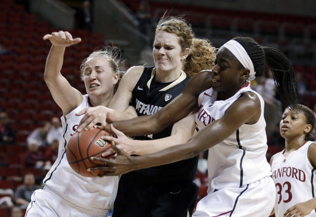 Stanford's Chiney Ogwumike, right, and Mikaela Ruef, left, battle with Colorado's Rachel Hargis, center, for the ball during the first half of an NCAA college basketball game in the second round of the Pac-12 women's tournament, Friday, March 7, 2014, in Seattle. Stanford won 69-54. (AP Photo/Ted S. Warren)