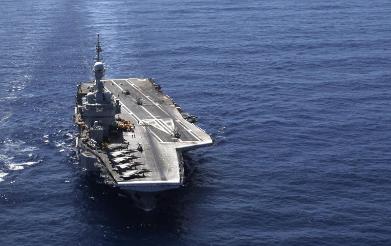FILE -- In this Tuesday, April 12, 2011 file photo, France's flagship Charles de Gaulle aircraft carrier, navigates in the Gulf of Sirte, off the Libyan coast. Despite growing controversy about the cost and relevance of aircraft carriers, navies around the world are adding new ones to their inventories at a pace unseen since World War II. The United States _ with more carriers than all other nations combined _ and established naval powers such as Britain, France and Russia are doing it. So are Brazil, India and China _ which with Russia form the BRIC grouping of emerging economic giants.(AP Photo/Christophe Ena, File)
