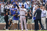 San Francisco Giants' Kris Bryant greets Chicago Cubs fans before a baseball game starts in Chicago, Friday, Sept. 10, 2021. (AP Photo/Nam Y. Huh)