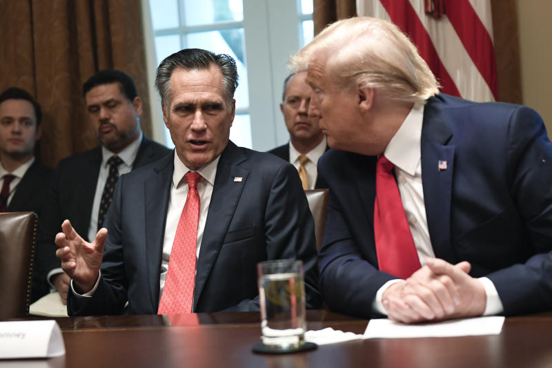 President Donald Trump, right, listens as Sen. Mitt Romney, R-Utah, third from left, speaks as they participate in a meeting in the Cabinet Room of the White House in Washington, Friday, Nov. 22, 2019, on youth vaping and the electronic cigarette epidemic. (AP Photo/Susan Walsh)