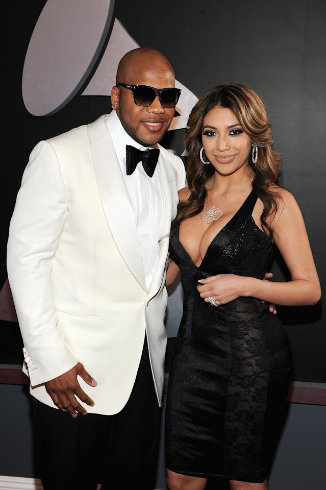 LOS ANGELES, CA - FEBRUARY 12:  Rapper Flo Rida and guest arrive at the 54th Annual GRAMMY Awards held at Staples Center on February 12, 2012 in Los Angeles, California.  (Photo by Larry Busacca/Getty Images For The Recording Academy)