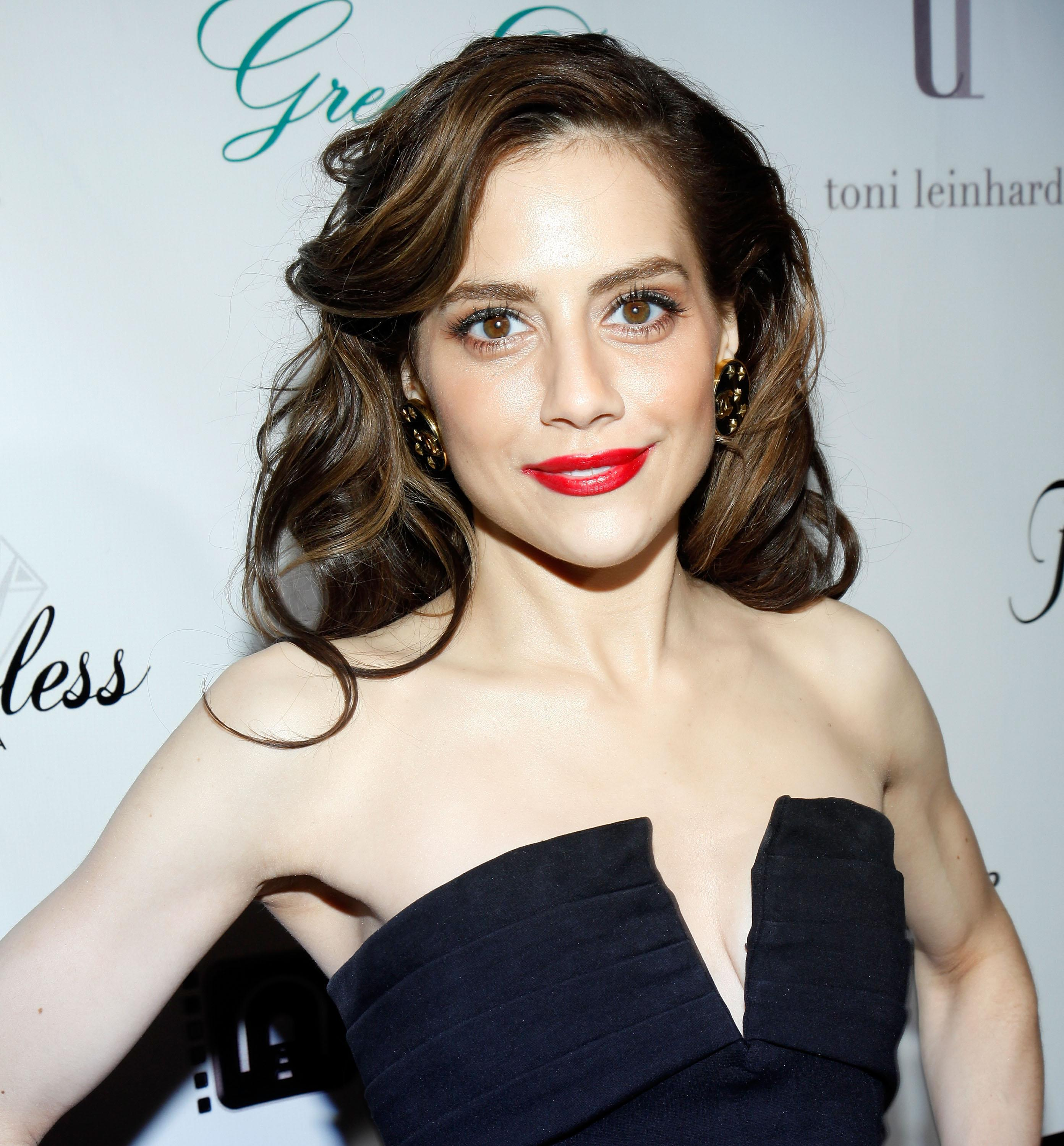 """BEVERLY HILLS, CA - DECEMBER 01: Actress Brittany Murphy attends """"Across The Hall"""" Los Angeles Premiere at Laemmle's Music Hall 3 on December 1, 2009 in Beverly Hills, California. (Photo by Brian To/FilmMagic)"""