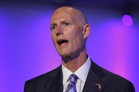 Florida Republican Gov. Rick Scott speaks at a ceremony opening new newsroom facilities for the Univision and Fusion television networks in Doral