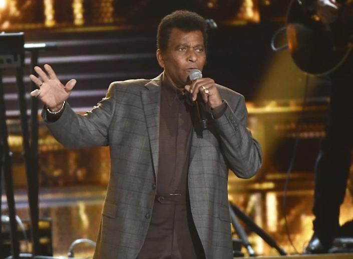 """FILE - Charley Pride performs """"Kiss An Angel Good Morning"""" at the 50th annual CMA Awards in Nashville, Tenn. on Nov. 3, 2016. Pride will get a lifetime achievement award at the CMA Awards in November. (Photo by Charles Sykes/Invision/AP, File)"""