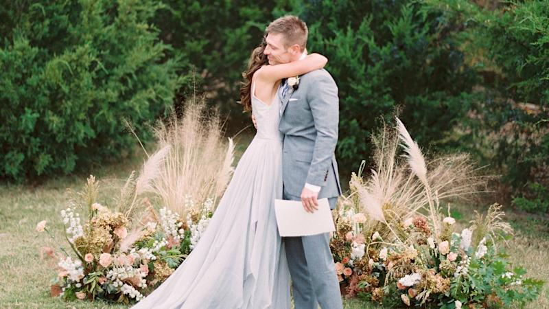 A Wedding Ceremony Trend We're Loving: Grounded Floral Arches