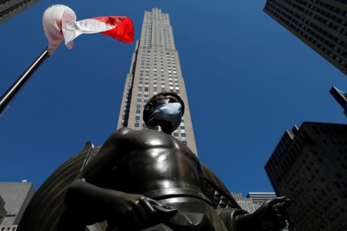 Statue at Rockefeller Center in Manhattan with face mask following outbreak of the coronavirus disease (COVID-19) in New York