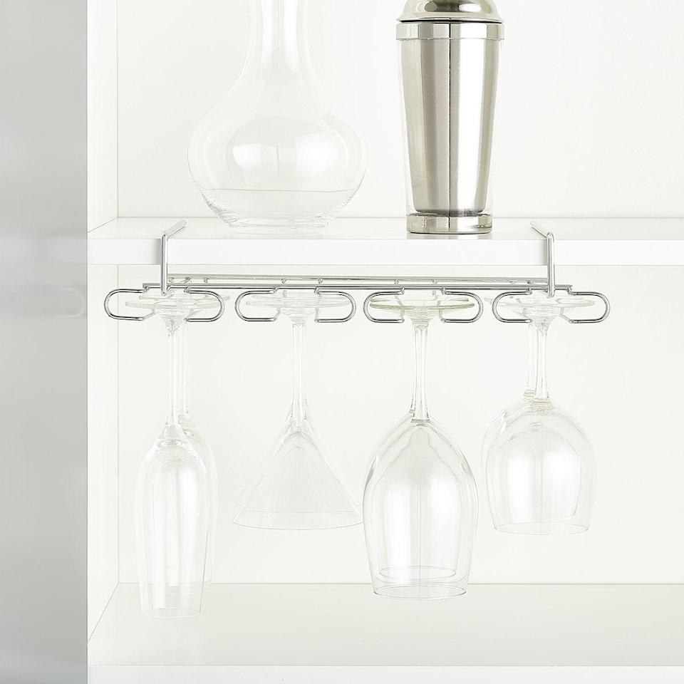 """<p><strong>Container Store</strong></p><p>containerstore.com</p><p><strong>$9.99</strong></p><p><a href=""""https://go.redirectingat.com?id=74968X1596630&url=https%3A%2F%2Fwww.containerstore.com%2Fs%2Fkitchen%2Fwine-racks-barware%2Fchrome-undershelf-stemware-holder%2F12d%3FproductId%3D11007769&sref=https%3A%2F%2Fwww.goodhousekeeping.com%2Fhome%2Fg35292976%2Ftop-kitchen-organization-tips%2F"""" rel=""""nofollow noopener"""" target=""""_blank"""" data-ylk=""""slk:BUY NOW"""" class=""""link rapid-noclick-resp"""">BUY NOW</a></p><p>Wine glasses and other stemware don't have to take up valuable cabinet space. Instead, hang them from the underside of the shelf to really maximize your storage.</p>"""