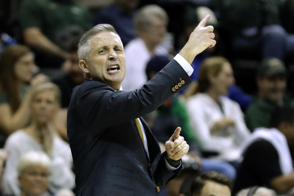 South Florida head coach Brian Gregory calls a play against Memphis during the first half of an NCAA college basketball game Sunday, Jan. 12, 2020, in Tampa, Fla. (AP Photo/Chris O'Meara)