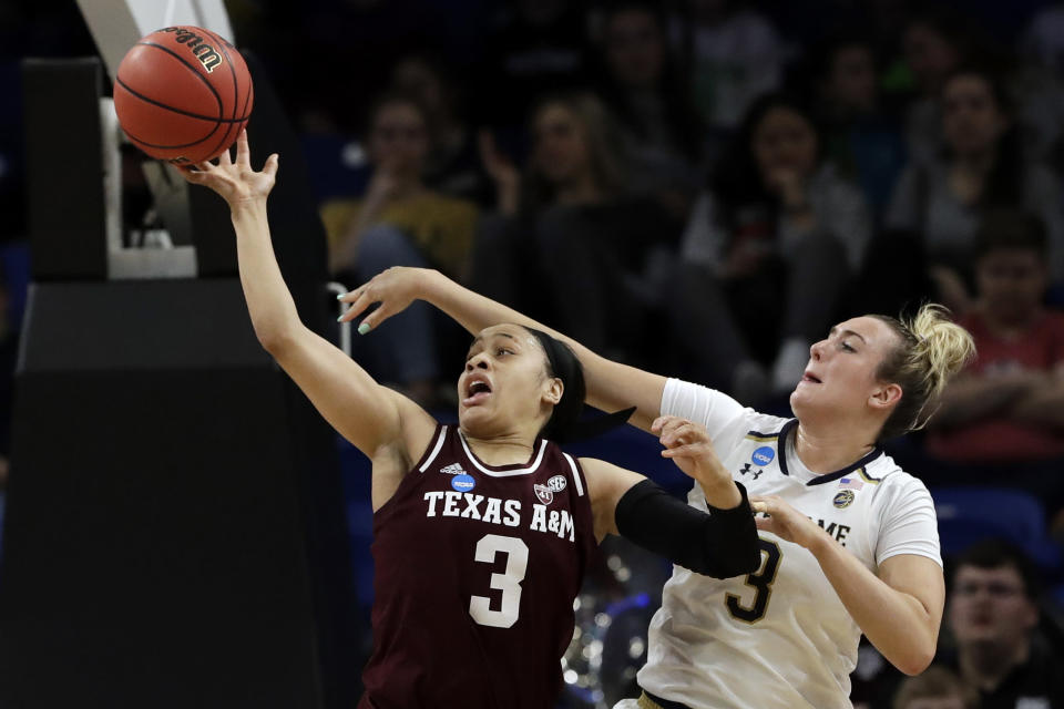 Texas A&M's Chennedy Carter, left, and Notre Dame's Marina Mabrey battle for a loose ball during the first half of a regional semifinal game in the NCAA women's college basketball tournament, Saturday, March 30, 2019, in Chicago. (AP Photo/Nam Y. Huh)