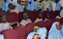 Some freed students from the Salihu Tanko Islamic School are reunited with their parents in Minna, Nigeria, Friday, Aug. 27, 2021. A school official in northern Nigeria says gunmen have released some of the more than 100 children who had been abducted back in May. The kidnapping victims from the Salihu Tanko Islamic School in Niger state had included children as young as 5 years old. (AP Photo)