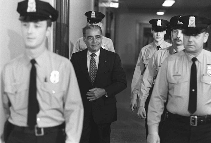 """<p>Longtime Nixon confidante Charles """"Bebe"""" Rebozo is flanked by Capitol policemen after being questioned by the Senate Watergate Committee, March 21, 1974. (Photo: AP) </p>"""