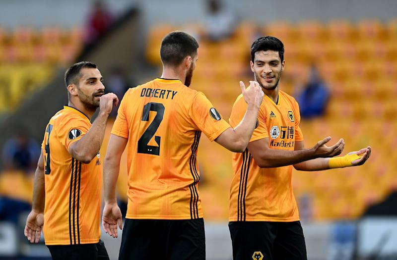WOLVERHAMPTON, ENGLAND - AUGUST 06: Raul Jimenez of Wolves celebrates after scoring his sides first goal during the UEFA Europa League round of 16 second leg match between Wolverhampton Wanderers and Olympiacos FC at Molineux on August 06, 2020 in Wolverhampton, England. (Photo by Laurence Griffiths/Getty Images)