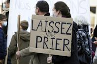 "Tighter restrictions have led to sporadic protests like one in Strasbourg, eastern France. The sign says ""let us pray"""