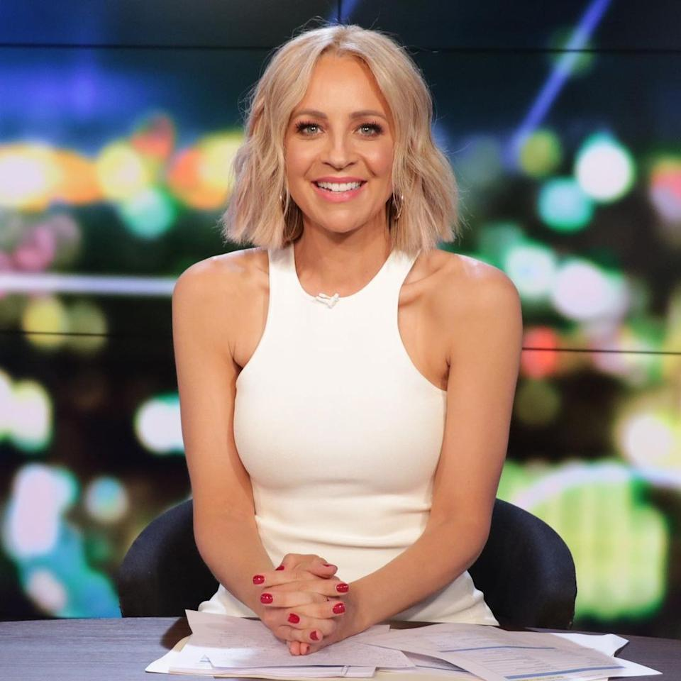 Carrie Bickmore wears a white sleeveless top on set of The Project