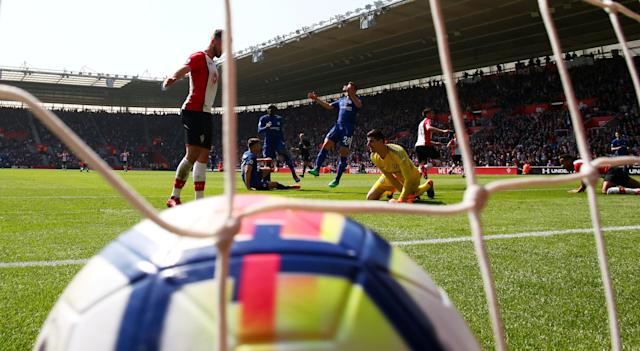 """Soccer Football - Premier League - Southampton vs Chelsea - St Mary's Stadium, Southampton, Britain - April 14, 2018 Southampton's Dusan Tadic celebrates scoring their first goal as Chelsea's Thibaut Courtois and Cesar Azpilicueta look dejected REUTERS/Ian Walton EDITORIAL USE ONLY. No use with unauthorized audio, video, data, fixture lists, club/league logos or """"live"""" services. Online in-match use limited to 75 images, no video emulation. No use in betting, games or single club/league/player publications. Please contact your account representative for further details. TPX IMAGES OF THE DAY"""