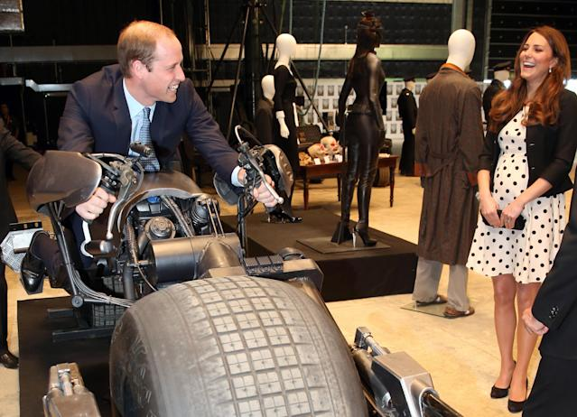 "<p> Britain's Kate the Duchess of Cambridge watches her husband Prince William as he sits on the 'Batpod' during the inauguration of ""Warner Bros. Studios Leavesden"" near Watford, approximately 18 miles north west of central London, Friday, April 26, 2013. As well as attending the inauguration Friday at the former World War II airfield site, the royals will undertake a tour of Warner Bros. ""Studio Tour London - The Making of Harry Potter"", where they will view props, costumes and models from the Harry Potter film series. (AP Photo/Chris Jackson, Pool)</p>"