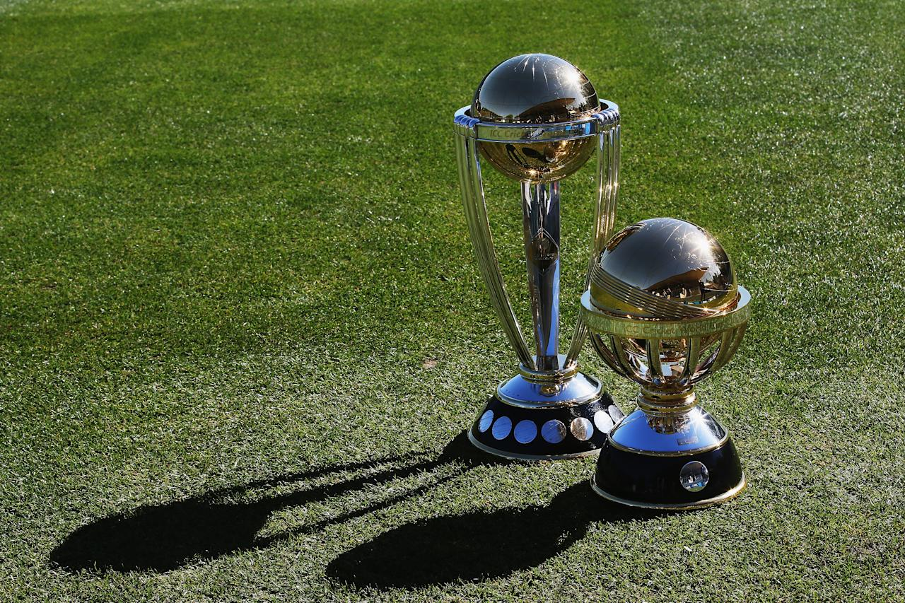 DUNEDIN, NEW ZEALAND - DECEMBER 04:  The Cricket World Cup trophy and the Cricket World Cup Qualifying trophy are displayed during the ICC Cricket World Cup Qualifier 2014 Media Launch at University Oval on December 4, 2013 in Dunedin, New Zealand.  (Photo by Hannah Johnston/Getty Images for ICC)