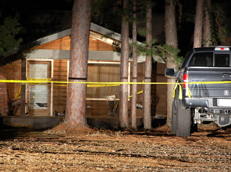Yellow crime-scene tape blocks off the front of a home in Heber Springs, Ark., where country singer Mindy McCready was found dead in an apparent suicide on Sunday, Feb. 17, 2013. She was 37. (AP Photo/Jeannie Nuss)