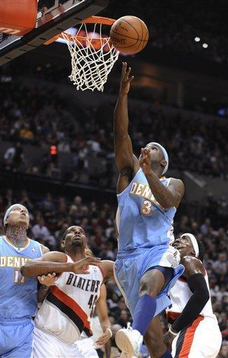 Denver Nuggets' Ty Lawson shoots against Portland Trail Blazers' Kurt Thomas (40) and Gerald Wallace during the first half of an NBA basketball game in Portland, Ore., Thursday, Dec 29, 2011. (AP Photo/Greg Wahl-Stephens)