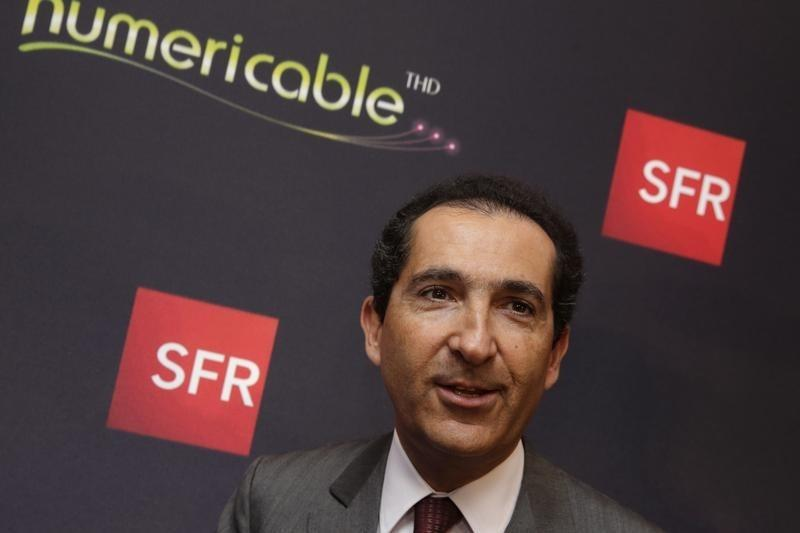 Drahi, Executive Chairman of cable and mobile telecoms company Altice and founder of Numericable, leaves a news conference in Paris