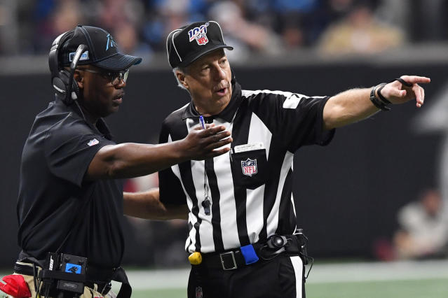 Carolina Panthers interim head coach Perry Fewell speaks with an offical during the second half of an NFL football game against the Atlanta Falcons, Sunday, Dec. 8, 2019, in Atlanta. (AP Photo/John Amis)