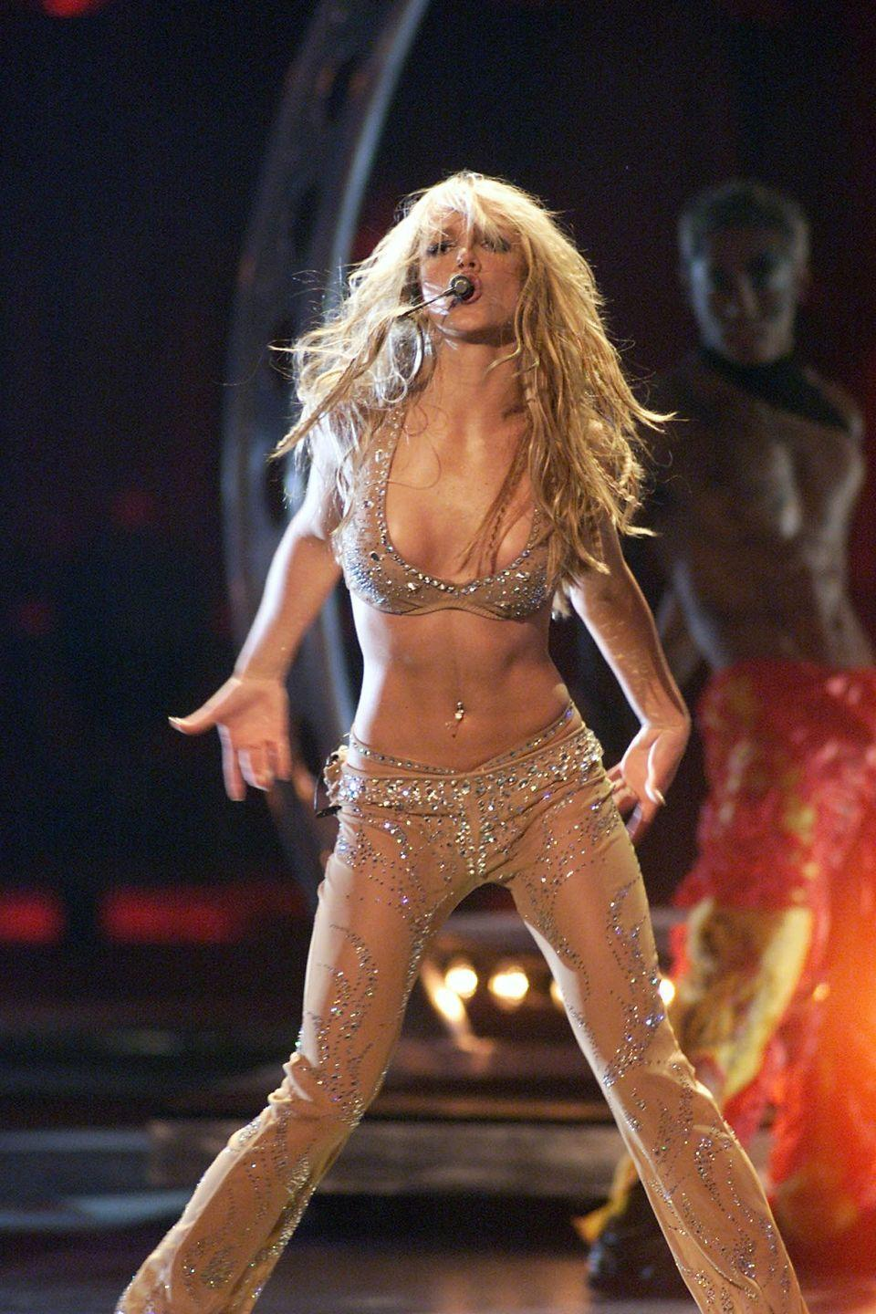<p>Performing at the 2000 MTV Video Music Awards in a sheer, nude costume accented with crystals.</p>
