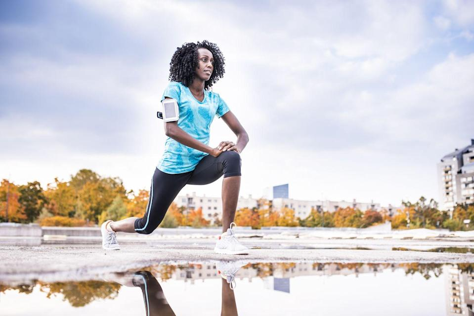 """<p><strong>Targets: </strong>Your <a rel=""""nofollow noopener"""" href=""""https://www.prevention.com/fitness/a20515287/best-abs-exercise-for-women/"""" target=""""_blank"""" data-ylk=""""slk:core"""" class=""""link rapid-noclick-resp"""">core </a>and hamstrings, plus opens up the hip flexors</p><p><strong>How to: </strong>Stand with your feet hip-width apart. Step your left foot back, lowering your body down so that both knees reach a 90-degree bend. Drive off the front heel to stand, bringing your left foot forward. Then, step right foot back, lowering into a 90-degree bend in both knees. Switch sides.</p>"""