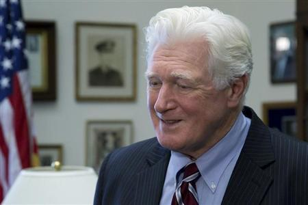 U.S. Representative Moran talks to a television reporter during interviews in his office on Capitol Hill in Washington