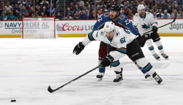 San Jose Sharks right wing Kevin Labanc, front, and Colorado Avalanche center Colin Wilson pursue the puck during the second period of Game 4 of an NHL hockey second-round playoff series Thursday, May 2, 2019, in Denver. (AP Photo/David Zalubowski)
