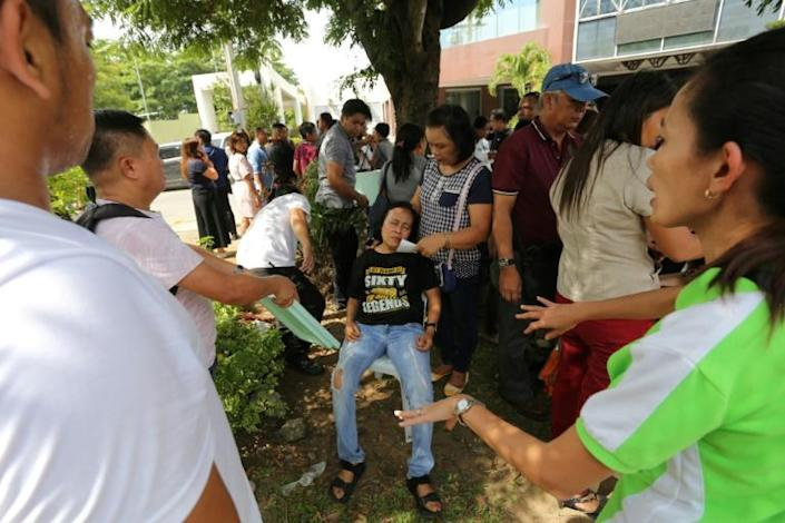 A powerful quake caused panic in some parts of Mindanao, shaking buildings and sending people running outside (AFP Photo/Manman Dejeto)